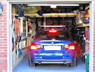 1 car garage parks bmw plus 7 high end bicycles, portable workshop and all tools