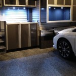 garage design & renovation, ctech cabinets, slatwall organization system, polyaspartic flooring on stairs, finished drywall, overhead bike storage, undermount lighting